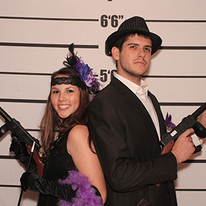 Seattle Murder Mystery party guests pose for mugshots